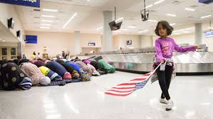 donald trump s education policies from kindergarten to grad school file photo a young girl dances an american flag in baggage claim while women