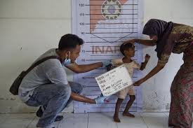 rohingya blogger burmese nobel prize winner aung san suu kyi has a rohingya boy from myanmar is photographed during police identification procedures at a newly set up confinement area in bayeun aceh province on 21