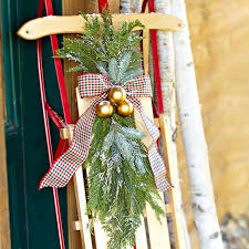 cabin decor lodge sled: decorated sled on a front porch