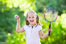 Active preschool girl playing <b>badminton</b> in outdoor court in summer ...