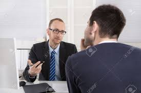 two businessman sitting in the office meeting or job interview stock photo two businessman sitting in the office meeting or job interview situation