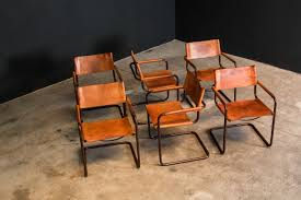 <b>Cantilever dining chairs</b> by Mart Stam for Fasem.   Castorina & Co.