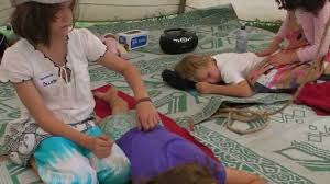 children massaging children at the eco festival
