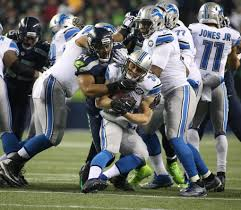 thomas rawls breaks through sets a seahawks playoff record for seahawk bobby wagner limits detroit s zach zenner to a 3 yard gain in the first