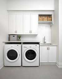 1000 ideas about laundry room cabinets on pinterest laundry rooms laundry and laundry room sink bright modern laundry room
