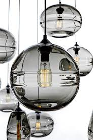 love the feeling of watery glass black glass globe pendant