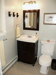 a black and white or off white color scheme creates contrast while keeping the design bathroom lighting ideas tips raftertales