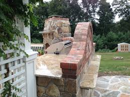 patio outdoor stone kitchen bar:  brought to the top with the yellow river granite which also pulls the yellow stone from the fireplace although this isnt my largest outdoor kitchen