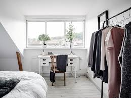 theres a small home office nook by the window and i love the tiny white chic small white home