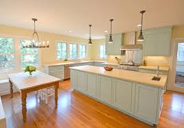 lavender foursquare farmhouse kitchen idea in dc metro with beaded inset cabinets blue cabinets limestone countertops brookside kitchen lighting