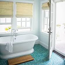 coastal bathroom designs: a gorgeous tile floor in a spectrum of ocean going blues and greens takes center