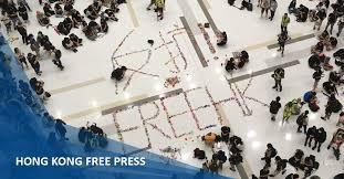 Protests against Hong Kong mask ban continue as MTR stations ...