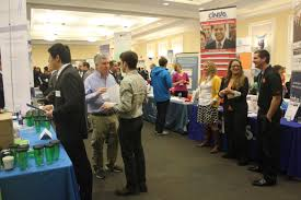 how do i career fair approaching recruiters the career you need something image of students talking recruiters at various booths during career fair