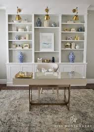 sophisticated home office features a bernhardt anjali writing desk paired with a nailhead wingback chair atop adorable office library furniture full size