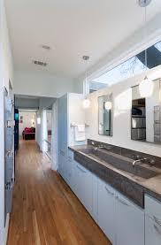 contemporary bathroom decorating ideas with clerestory concrete concrete countertop double sink double vanity hallway narrow bathroom pendant lighting bathroom pendant lighting double vanity modern