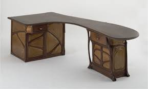 unique shape computer table made of wood material in two tone finish having carved accent and art deco desk computer