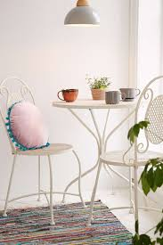 modern eclectic breakfast nook with white furniture sets round table and beautiful chairs with modern pendant and colorful area rug white interior breakfast breakfast furniture sets