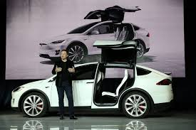 new car launches in early 2015Tesla delivered a ton of cars in latest quarter says analyst
