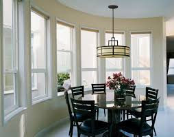 round white marble dining table: dark brown marble dining table between modern white dining chairs