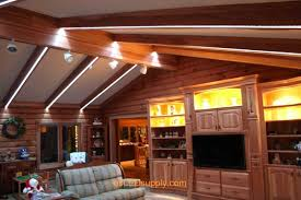 livingroom with rgb flexible led strips running along the beams for lighting and color chaning effects cabin lighting ideas