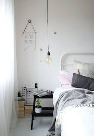 my bedroom inspiration for a mid sized scandinavian master bedroom remodel in kent with white walls bedside wall lighting