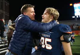 rochester vs johnsburg ihsa a championship friday nov  rochester s mikey mcnicholas 85 celebrates his father mike mcnicholas after the rockets