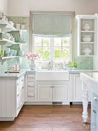 features like a bridge style faucet an apron front sink and varying shades of green subway tiles add country charm to this kitchen charming shabby chic kitchen