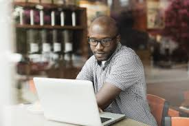 cover letter tips for older job seekers man using laptop in coffee shop