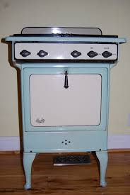 vintage kitchen appliance retro appliances: vintage enameled gas oven stove in mint green and creamy yellow  via etsy