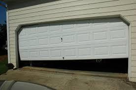 Image result for garage door off track
