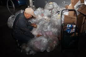 dumpster diving in brooklyn photos business insider dumpster diver robert hernandez looks through garbage bags outside of the starbucks at court and joralemon streets in brooklyn new york