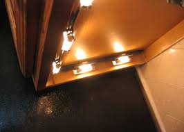 image of under cabinet puck lighting cabinet xenon lighting