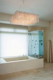 large size design black goldfish bath accessories: kanyes bath inclusive of a tank filled with black moor and chocolate organda goldfish amazing chandelier white bathroom home interior design