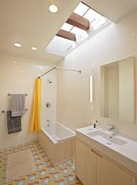 view in gallery eclectic bathroom with a cool grazing skylight design jordan parnass digital architecture ample shower lighting