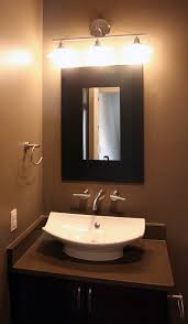 image of dazzling designer powder room vanities with white ceramic vessel sink on black painted cabinets attractive vanity lighting bathroom lighting