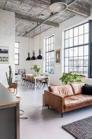rustic industrial dining room sets rustic and industrial dining room with high ceilings and large windows