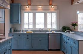 painted blue kitchen cabinets house:  blue kitchen with alessi teapot beach house beams bin pulls blue blue blue kitchen cabinets