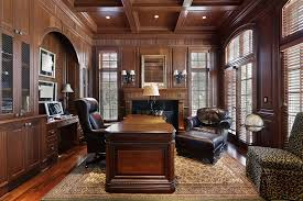 richly appointed home office and den with large dark wood furniture extensive wood paneling basement den home design photos basement home office ideas home office decorating