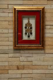 indian predominently living asian style decor framed brass bells  framed brass bells