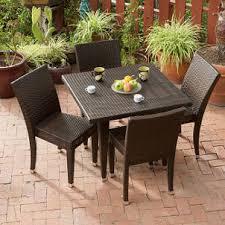 brown wicker outdoor furniture dresses: dark brown wicker outdoor furniture dresses up patio