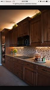 decor for above kitchen cabinets