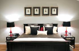 view in gallery simple and effective addition of red accents black grey white bedroom