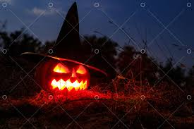 Spooky <b>Halloween pumpkin</b> jack-o-lantern in <b>witch</b> hat with burning ...