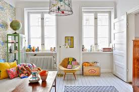 the owners have used a white base floors walls and ceilings and added fabulous svenskt tenn wallpaper ferm living rugs and brightly coloured furniture bright coloured furniture