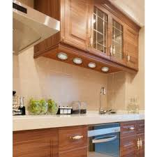 a kitchen counter illuminated with under cabinet puck lights cabinets lighting