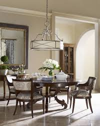 dining room table mirror top:  vintage dining table and chair with  motif fabric armchairs and rounded wooden table