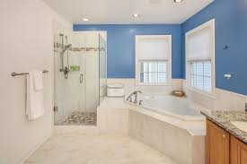 ideas bathroom tile color cream neutral: the light cream marble tile extends into the bathtub enclosure with brushed nickel fixtures