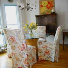 dining table parson chairs interior: dining room with slipcovered parson chair and round dining table also chandelier