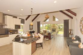 open plan kitchen design offers genova a single story  sq ft garden home that offers a private side en