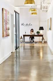 bright industrial office space with gold pendant lights concrete floors and large art boston office space charles